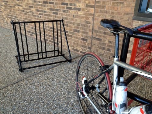 I turn my red tire to TJ's bike rack like a baboon turns his red butt to his enemy